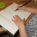 Ellen staver og skriver